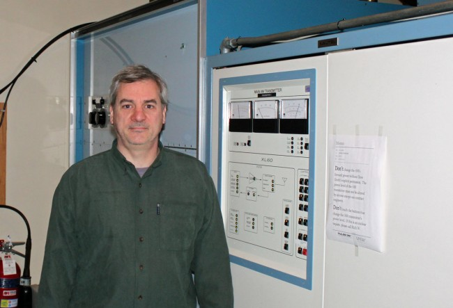 Paul Thurst standing in front of a Nautel XL60 medium wave transmitter
