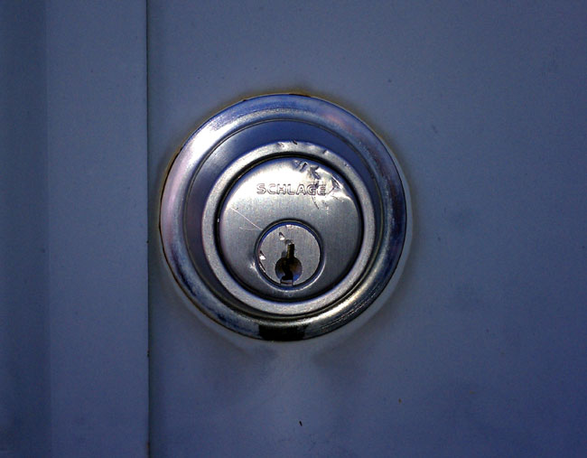 Dented deadbolt lock at transmitter site