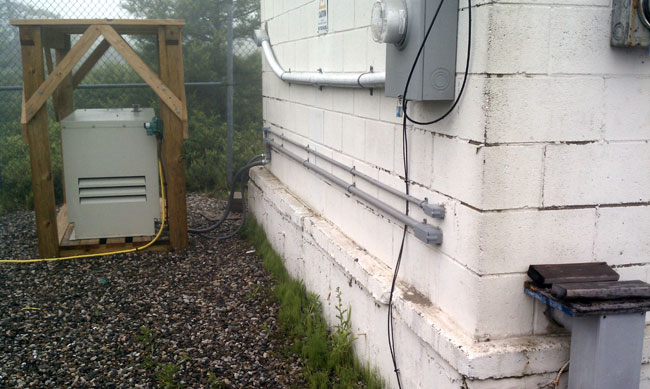 Onan RS-15000 generator wired to transmitter building