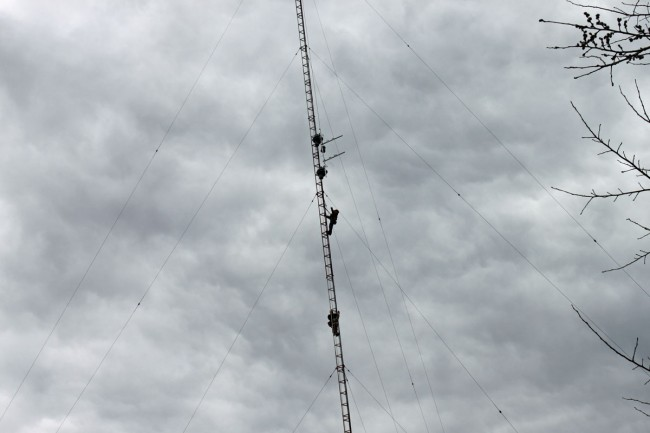 Tower crew hanging translator antenna on AM tower