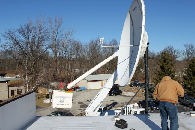 Bucket truck satellite dish maintenance