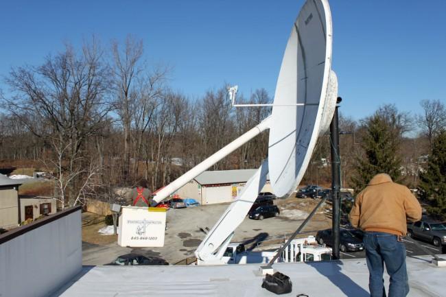 Bucket truck satellite dish maintenance