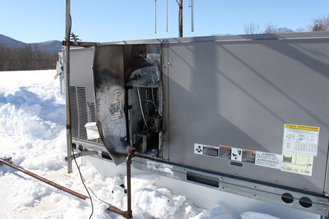 Carrier HVAC unit damaged by fire