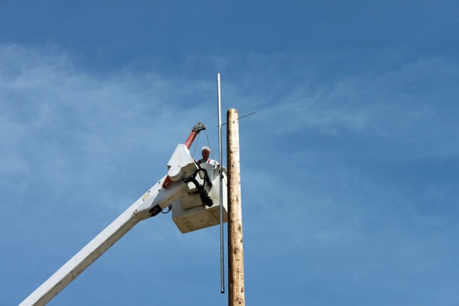 Mounting pole to tower