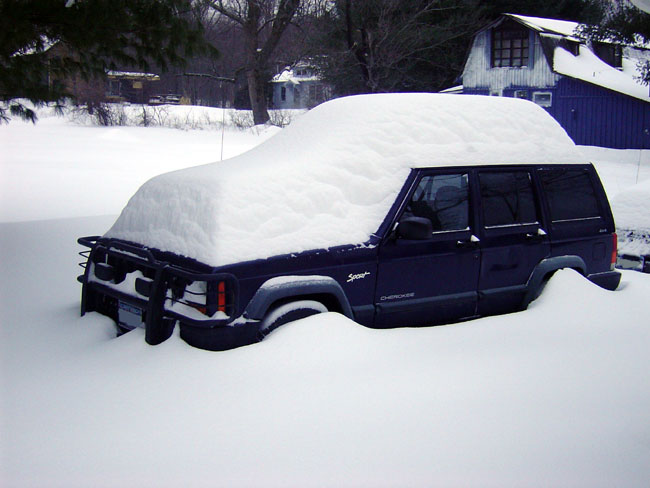 1997 Jeep Cherokee in early April snowstorm