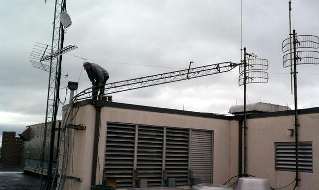 Damaged Rohn 25G STL tower on roof of studio